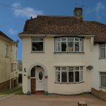 Image of front of a house in Greenfield Crescent Patcham Brighton | Open House Estate Agents Brighton