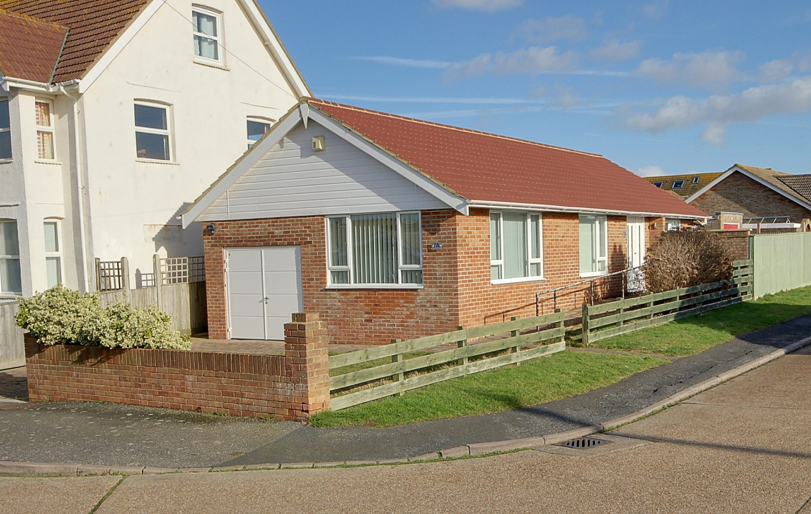 Image of the outside of a detached bungalow in Peacehaven | Open House Estate Agents Peacehaven