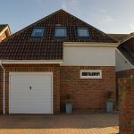Image of the front of a detached House in Peacehaven | Open House Estate Agents Peacehaven