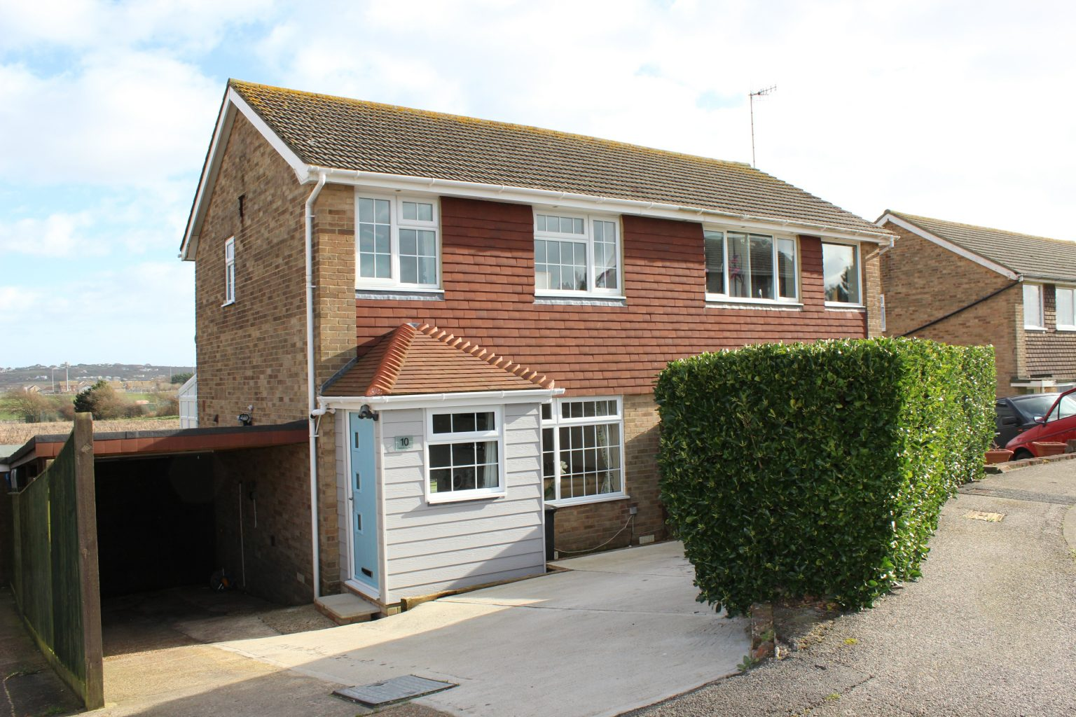 Image of the outside of a semi detached house in Peacehaven | Open House Estate Agents Peacehaven