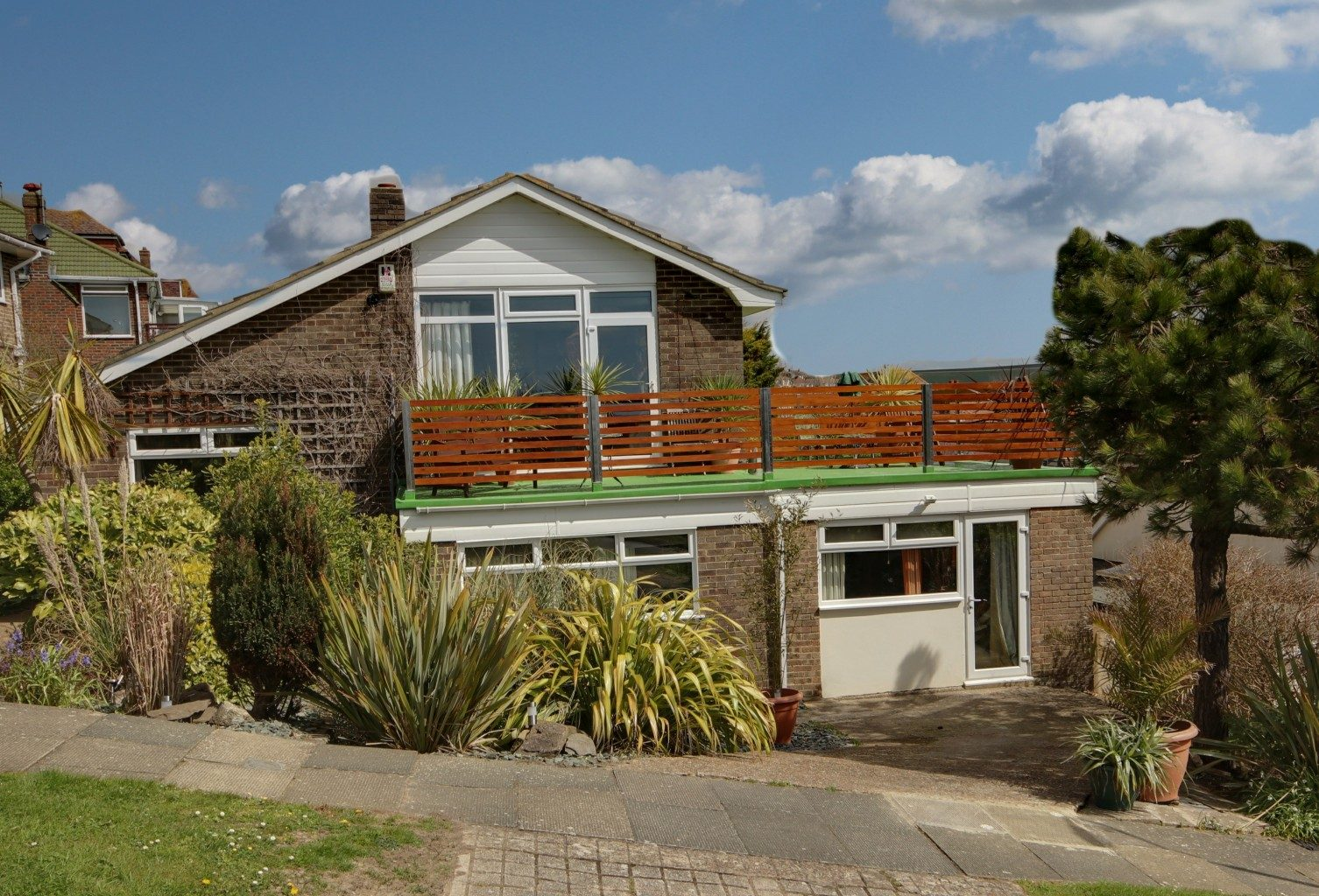 Image of the front of a house in Saltdean| Open House Saltdean