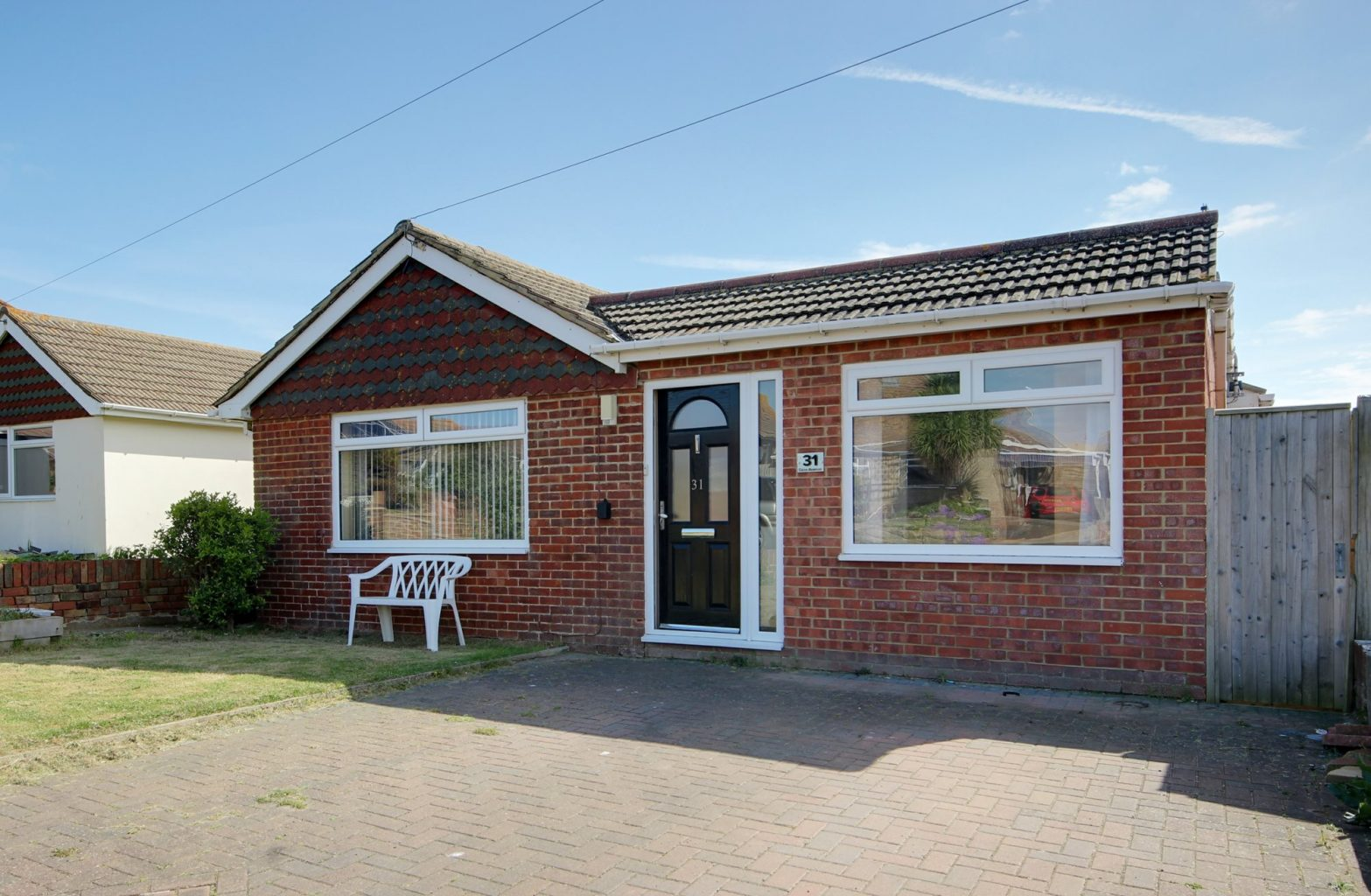 Image of the front of a detached bungalow in Peacehaven | Open House Estate Agents Peacehaven
